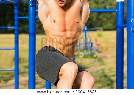 Man Performing Side Crunches During Street Workout