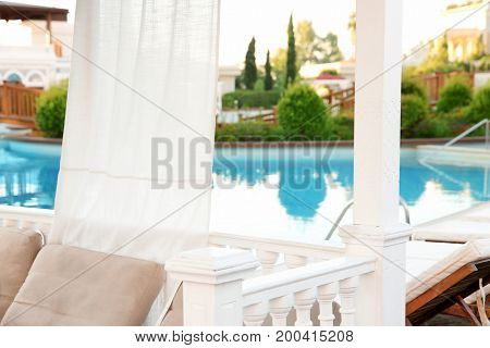 Place for rest near swimming pool in luxury hotel