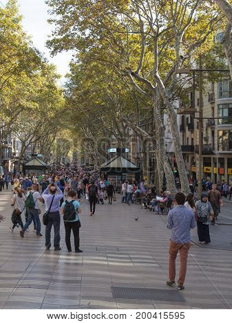 Barcelona - October 10 2015: Happy people are walking and taking pictures in the Rambla street in Barcelona October 10 2015 Barcelona Spain