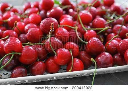 Tray with fresh ripe cherries, close up