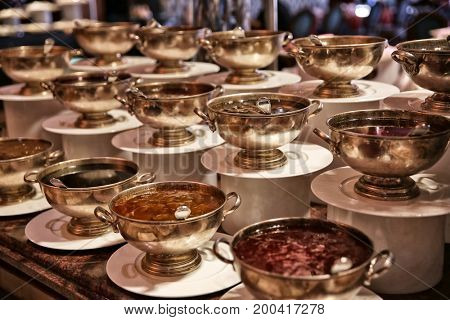 Different kinds of jams in bowls on table at buffet