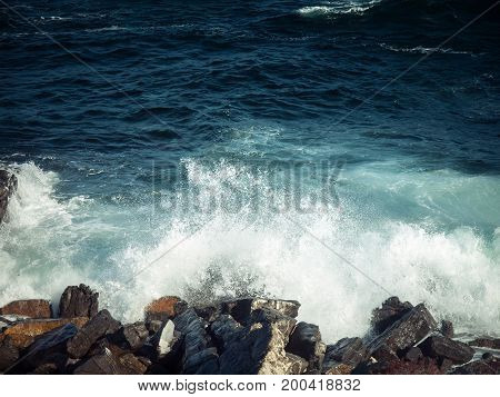 rocky coastline with splashing waves in the straight of Gibraltar Spain Europe