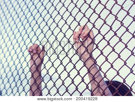 Young woman hold cage with sad and hopeless