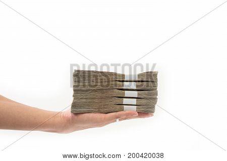 Hand Holding Stack Of Many Thai Money On White Background.