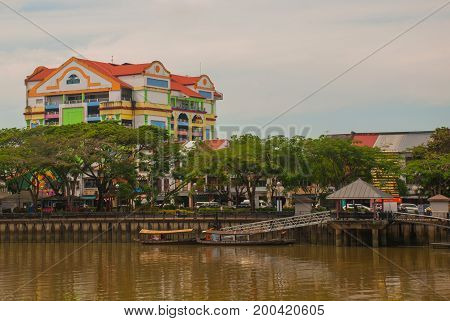 Landscape With A View Of The River And Beautiful Multi-colored Building. Kuching, Sarawak, Malaysia