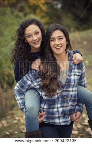Hispanic Teenage girls having fun together outdoors