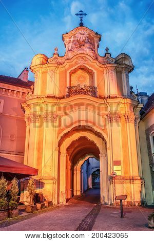 Vilnius, Lithuania: Basilian Gate of Church and Monastery of Holy Trinity, Lithuanian Sv. Trejybes cerkves ir vienuolyno Bazilionu vartai, in the sunrise
