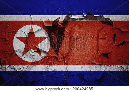 Flag north korea on abstract background plaster, brick, concept of the collapse of the country, rising, civil war, tense relationship at the border.