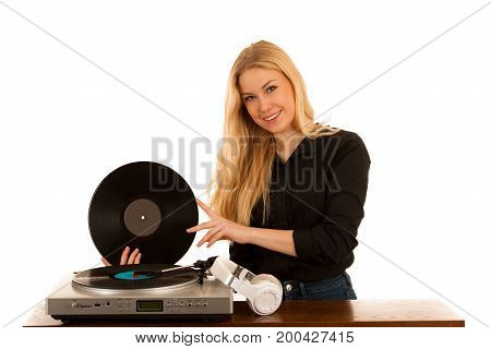 Woman Listening Music On Gramophone With Vinyl In Her Hands Isolated Over White