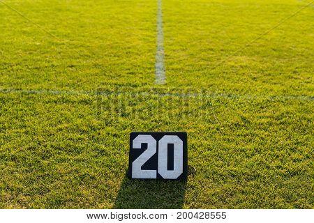 the twenty yard line marker at an evening rehearsal