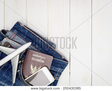 Vacation Travel objects in a hipster jean pocket