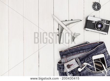 Hipster travel objects on white wood copy space