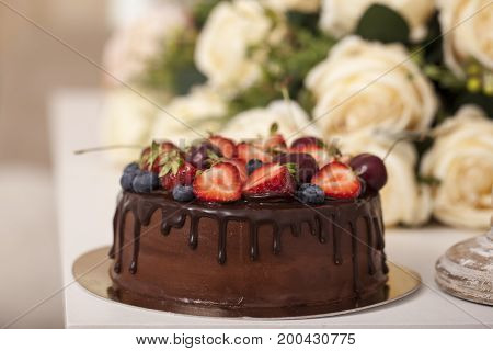 Chocolate Cake With Berries With Beauty Background.