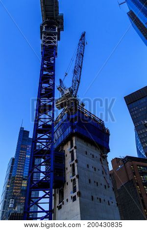 LONDON, GREAT BRITAIN - MAY 16, 2014: It is a night view of one of the existing and under construction skyscrapers in the City of London.