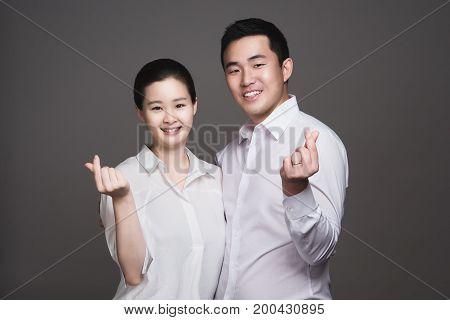 Studio portrait of 30s happy asian couple - isolated