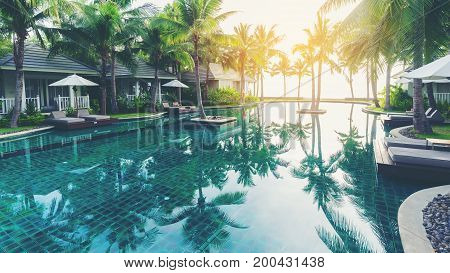 Prachuap Khiri Khan Thailand - September 24 2016 : Luxury swimming pool in front of private tropical villas in Hua Hin hotel