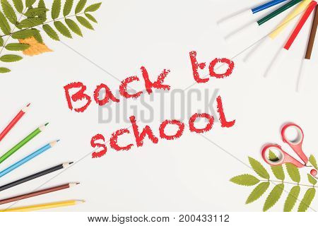 Office and student accessories on a white. Supplies on white background top view. Back to school text concept. Copy space