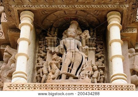 India Sculptures religious erotic sybmboli of the Indian faith on walls of temples in Khujaraho temples. Madhya Pradesh