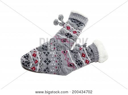 Warm, winter women's socks with a pattern close up on a white background
