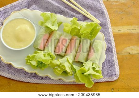 imitation crab stick and green oak wrapped flour paste dipping cream sauce on plate