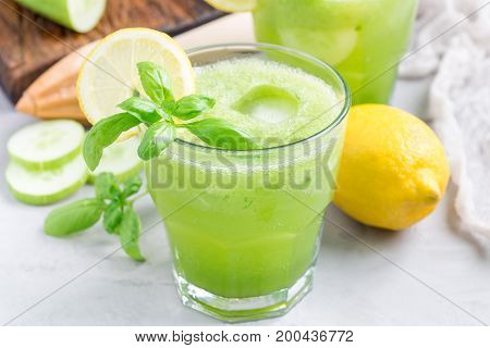 Healthy homemade lemonade with cucumber basil lemon honey and sparkling water horizontal
