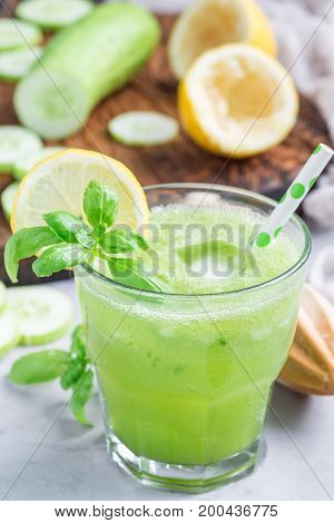 Healthy homemade lemonade with cucumber basil lemon honey and sparkling water vertical