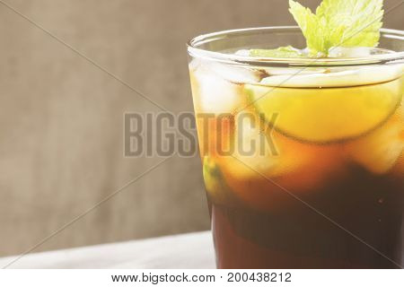 Cocktail Cuba Libre In A Glass On A Dark Background. Copy Space. Food Background. Toning