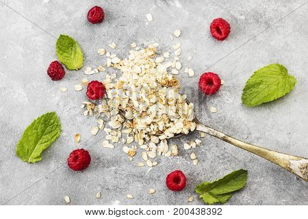 Glanola In Spoon With Raspberry And Mint On A Gray Background. Top View. Food Background