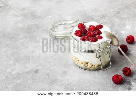 Glanola In Glass Jar With Raspberry On A Gray Background. Copy Space. Food Background