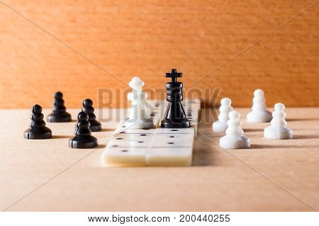 Chess king and queen white and black on a wooden background