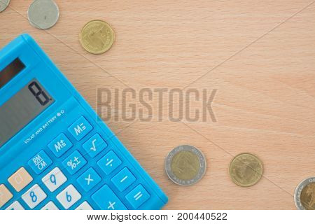 Calculator and Pound coins from bank. Financial and Business concept.