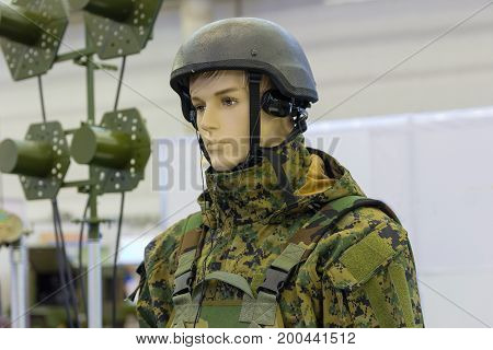 Dummy in army helmet with headphones. Armament