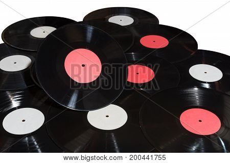 Many vinyl discs with red and white label on white background