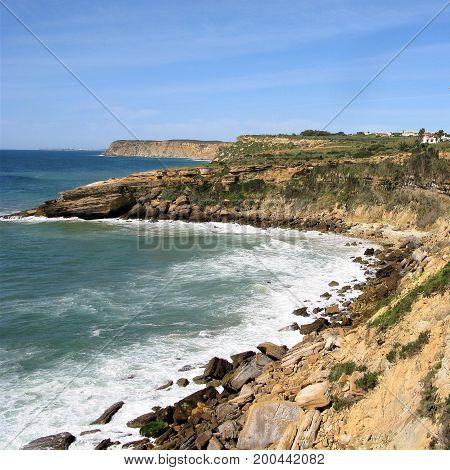 Rocky coastline with bays and headlands in the Algarve, Portugal
