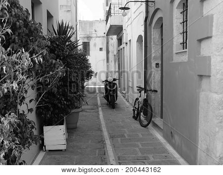 A gentle summer morning on a narrow street in Rethymno Greece