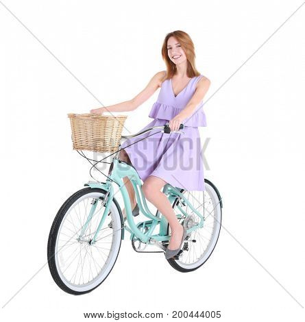 Young smiling girl with bicycle on white background