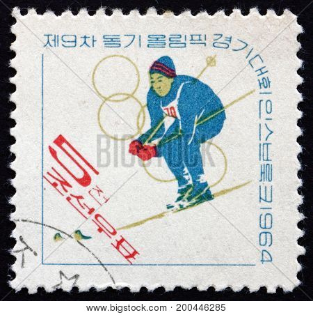 NORTH KOREA - CIRCA 1964: a stamp printed in North Korea shows Skier 9th Winter Olympic Games Innsbruck circa 1964