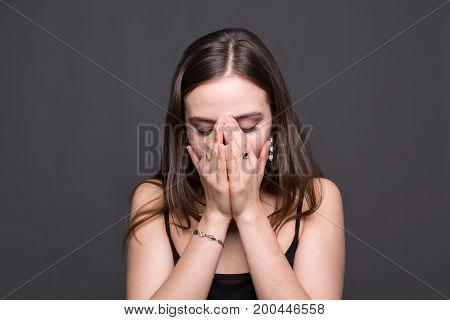 Emotional woman, facial expressions, crying girl on dark background