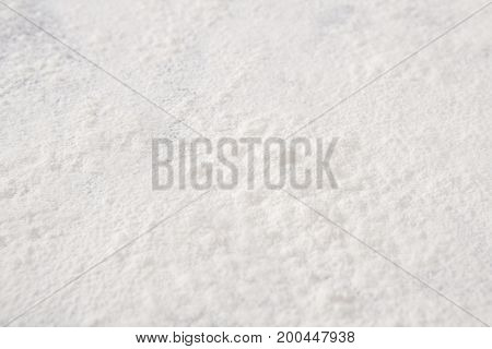 Wheat flour texture, abstract background. Top view. Baking concept, cooking dough or pastry.