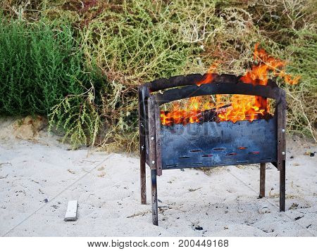 Barbecue Grill With Fire On Nature, Outdoor, Close Up. Hot Empty Bbq Charcoal Grill With Flames In T