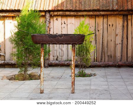 Empty Metal Barbecue For Cooking Kebabs, Meat And Vegetables On Charcoal. Well Arranged Territory Of