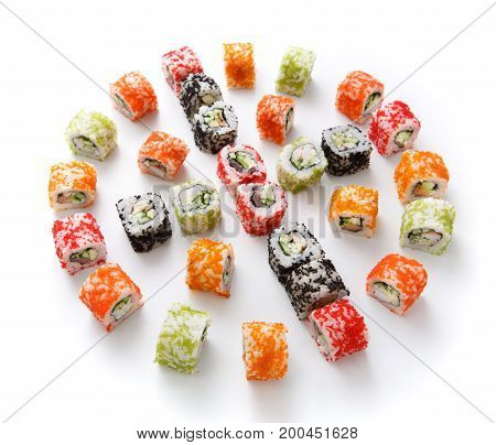 Sushi assortment isolated on white background. Big set of seafood rolls in colorful tobiko caviar. Japanese food delivery