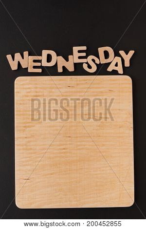Word Wednesday with blank wooden board. Timetable, day of week, to-do-list, time management concept