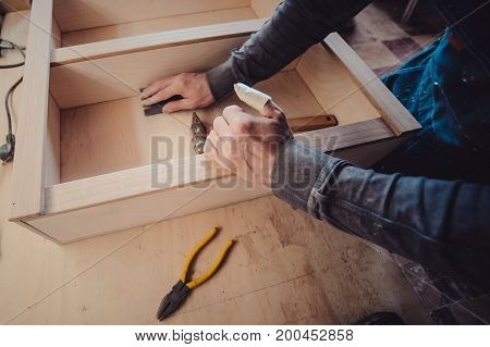 Man Builds Furniture In The Carpentry Shop.