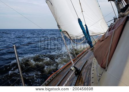 Boat bow sailing in Baltic sea in summer vacation