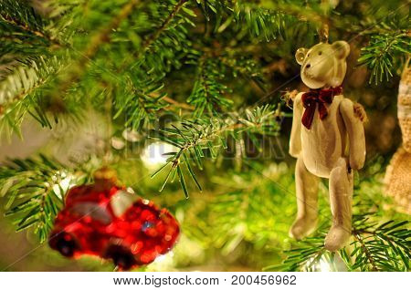 Christmas tree decorations Red car bauble and teddybear.