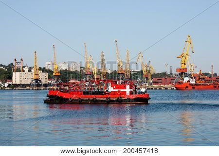 seaport with cranes and cargo ships, black sea