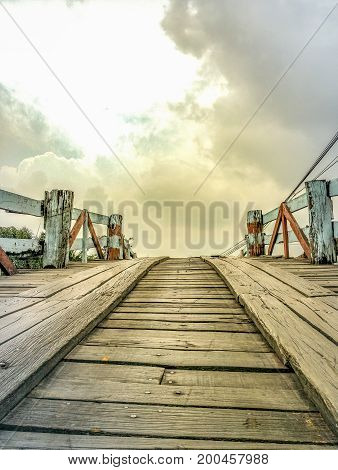 A new day on a wooden bridge across a canal.
