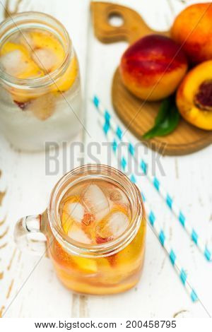 Homemade Iced Lemonade With Ripe Peaches. Fresh Peach Ice Tea In A Mason Jar. Top View.