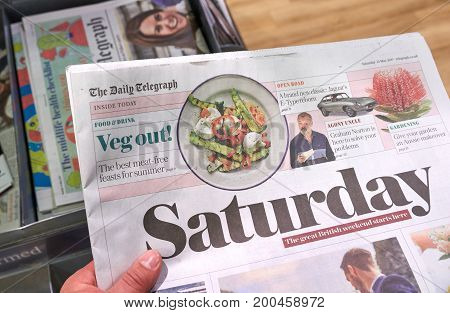 LONDON ENGLAND - MAY 14 2017 : The Daily Telegraph Saturday newspaper. The Daily Telegraph commonly referred to simply as The Telegraph is a national British daily broadsheet newspaper.